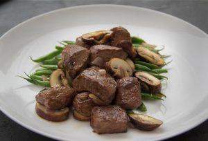 Organic Grass Fed Beef steak tips with mushrooms and green beans