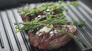 Organic Grass Fed Beef filet mignon on cast iron grill