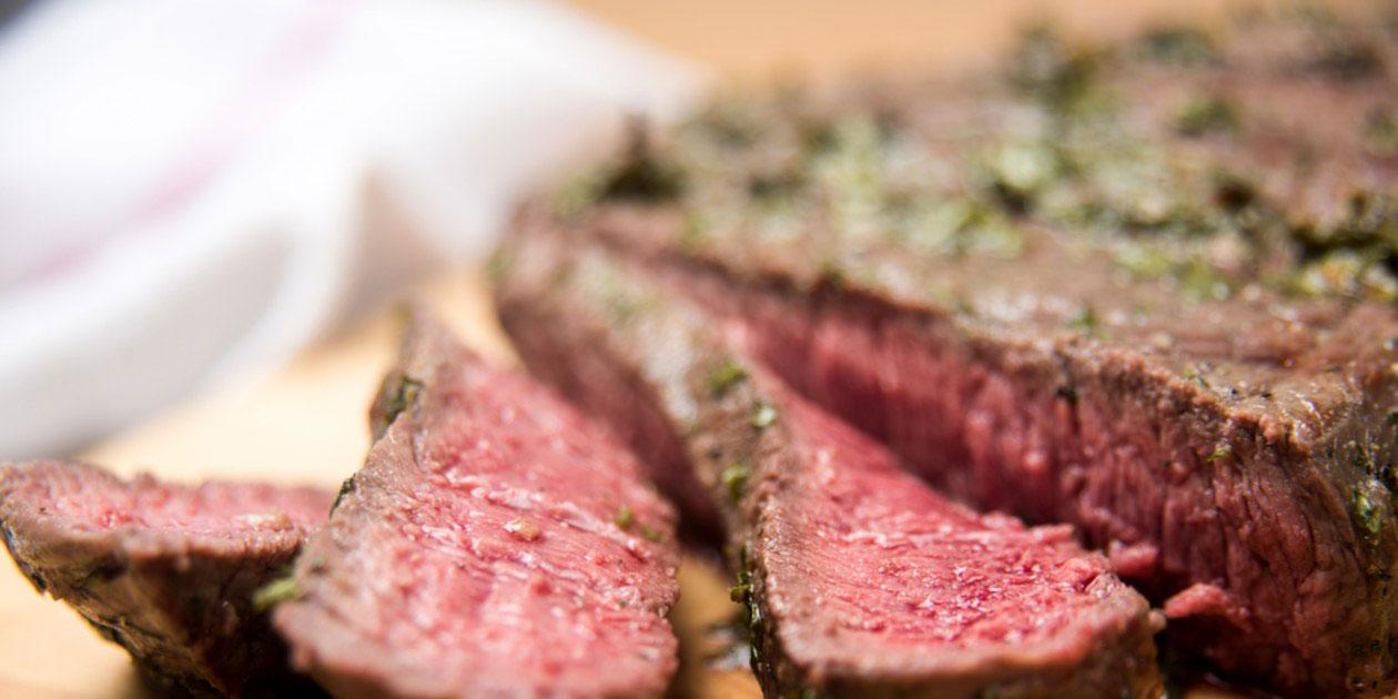 Organic grass fed london broil steak with herb rub cut into strips