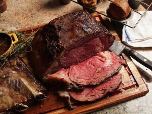 grass fed rib eye roast cooked to rare and sliced