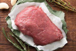 raw organic grass fed beef ribeye steak