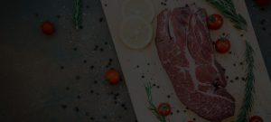 large cut of steak on cutting board from american farms