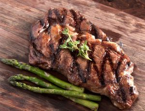grass fed ribeye steak paired with asparagus